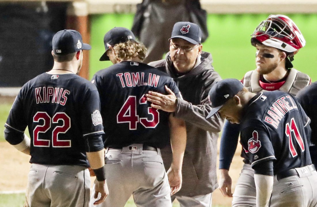 Cleveland Indians starting pitcher Josh Tomlin gets a hug from manager Terry Francona after being taken out of the game during the fifth inning of Game 3 of the Major League Baseball World Series against the Chicago Cubs Friday, Oct. 28, 2016, in Chicago. (AP Photo/Charlie Riedel)