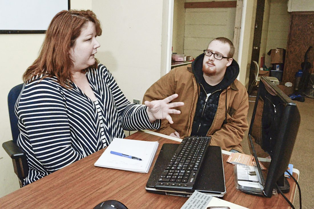 Mathew Blinco, 23, originally from Mansfield now living in Warren, right, goes over the job seeking process with Trumbull County Take Flight executive director Susan Griesinger....by R. Michael Semple