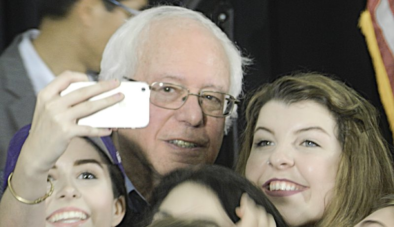 Tribune Chronicle  / Guy Vogrin  Former Democratic presidential candidate U.S. Sen. Bernie Sanders of Vermont gets a selfie with an unidentified student during a campaign stop for Democratic nominee Hillary Clinton on Thursday at Youngstown State University.
