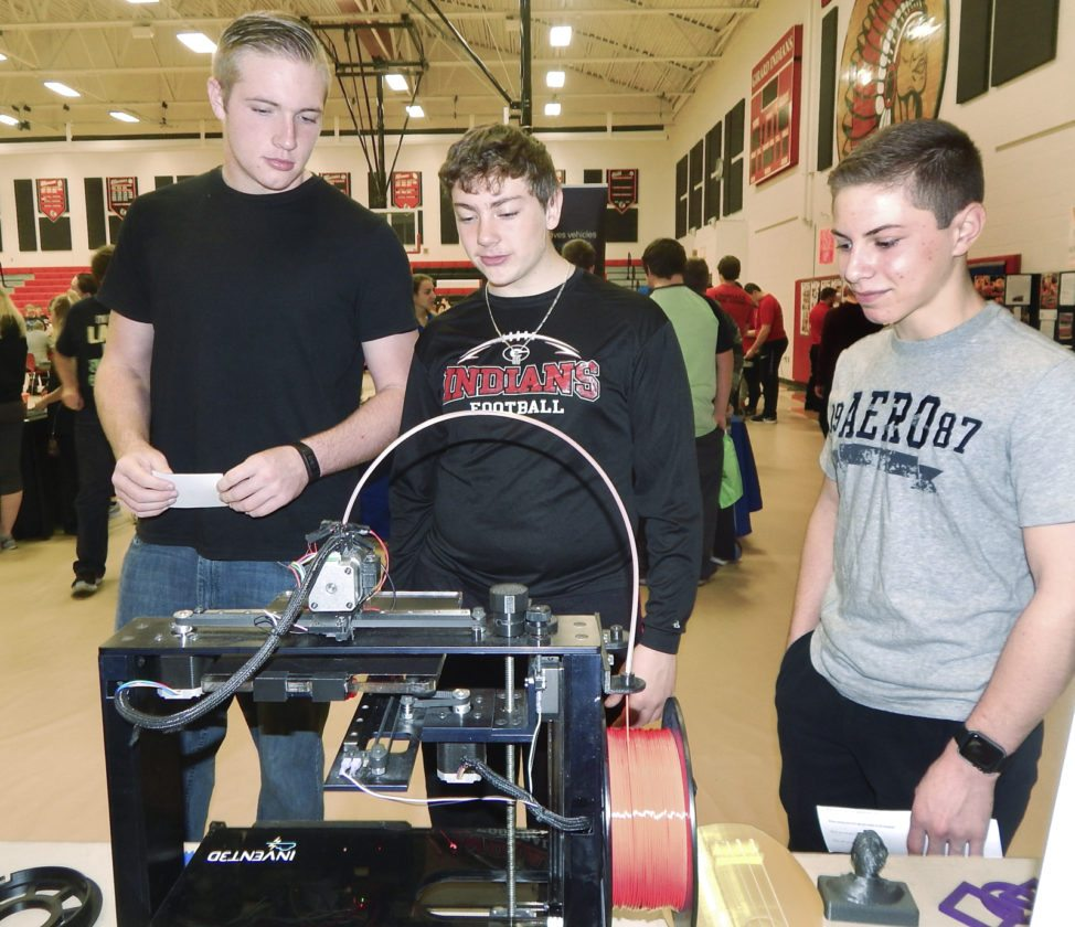 Tribune Chronicle / Bob Coupland  At Thursday's  Engineering, Technology and Manufacturing Career Fair at Girard High School, ninth-graders, from left, Haeden Gump, Nathan Mitchell and Alex DelGarbino check out an Inventor Cloud 3-D printer made at Applied Systems Technology in Youngstown.