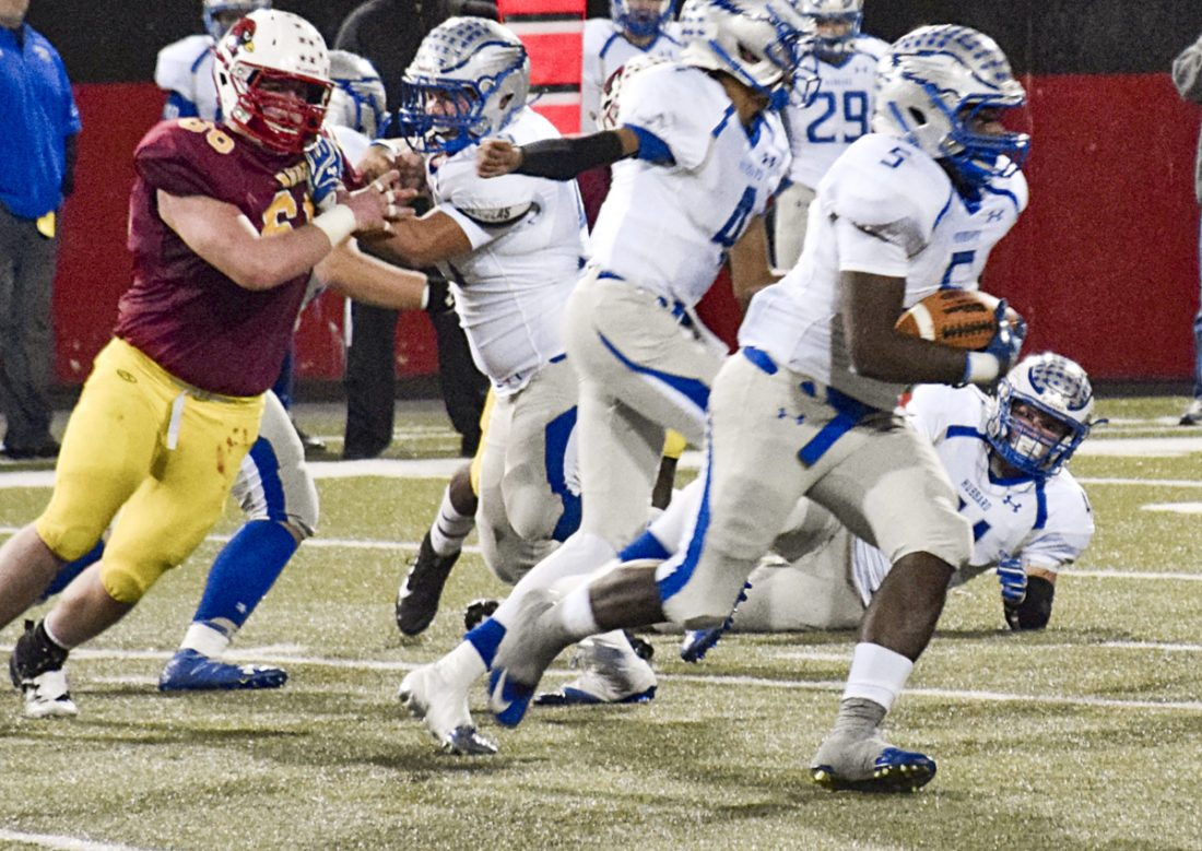 Tribune Chronicle / Eric Murray Rafael Morales (5) of Hubbard looks for running room Friday night in the Eagles' 27-9 loss to Cardinal Mooney.