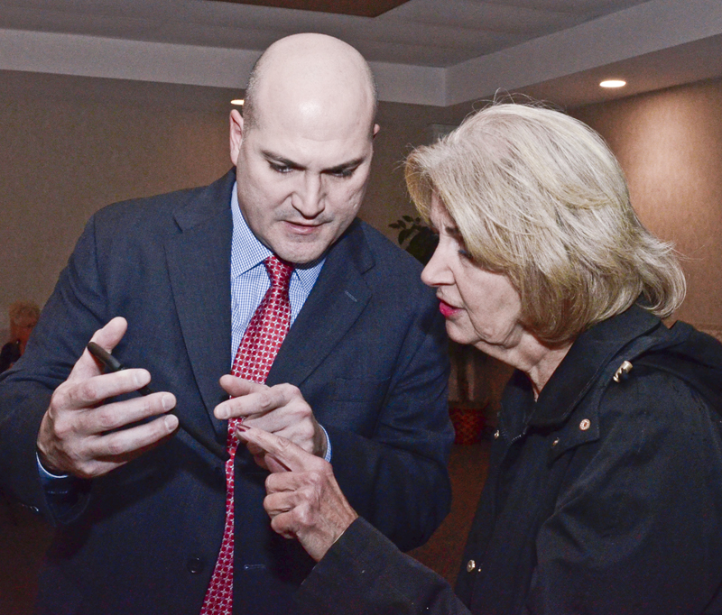 Tribune Chronicle / R. Michael Semple Trumbull County Commissioner Mauro Cantalamessa, left, and supporter Diana Alejars of Girard, view election results on a smartphone at the Democratic victory party Tuesday at Enzo's Restuarant in Warren. Cantalamessa easily won re-election, defeating Jim Priester by a vote of 60 percent to 40 percent, according to incomplete and unofficial results from the Trumbull County Board of Elections.
