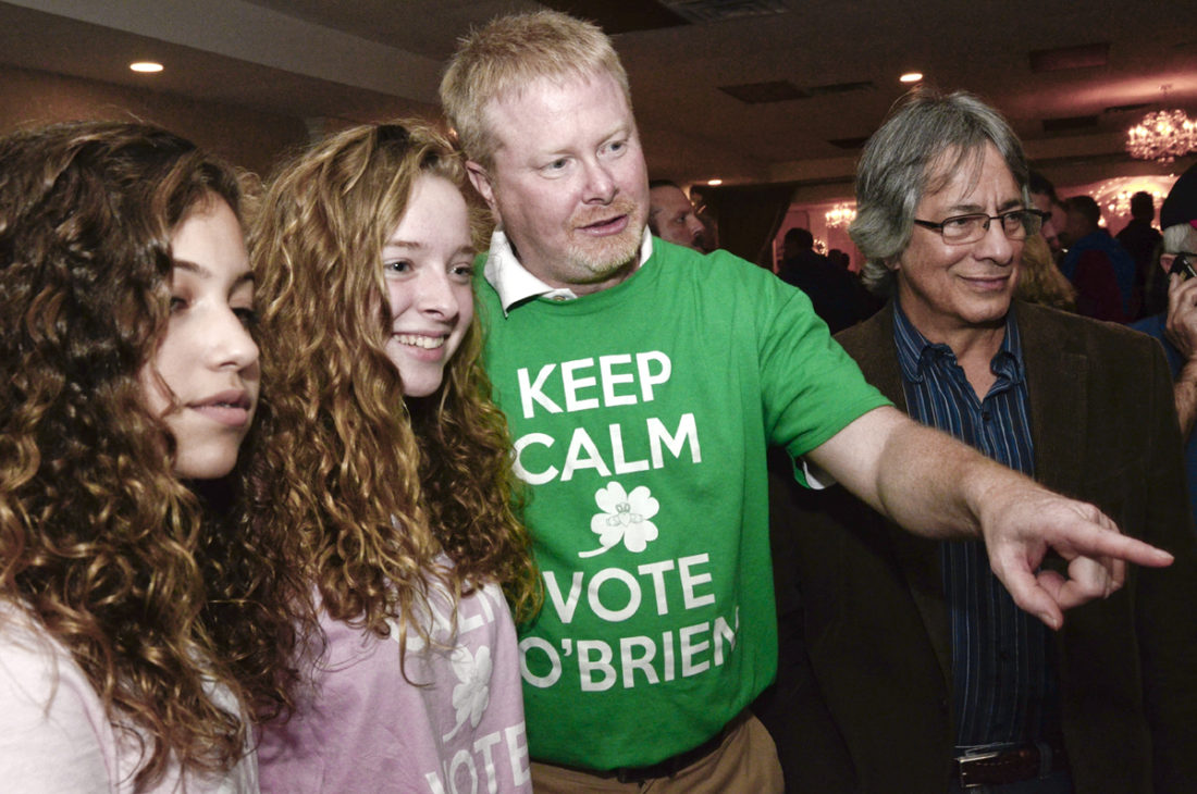 Tribune Chronicle / R. Michael Semple Sean O'Brien, right, watches election results Tuesday at Enzo's Restaurant with his daughter, Gillian O'Brien, 13, center, and her friend, Alexis Terlecky, 13, left, both of Howland. O'Brien won the 32nd Ohio Senate seat thanks to a landslide victory in Trumbull County, which has more registered voters than Geauga and Ashtabula counties combined.