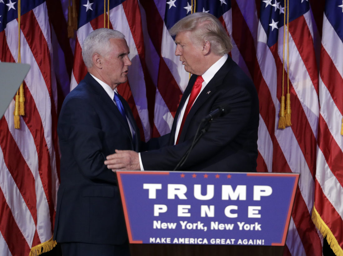 President-elect Donald Trump, right, shakes hands with Vice-President-elect Mike Pence during his election night rally, Wednesday, Nov. 9, 2016, in New York. (AP Photo/John Locher)