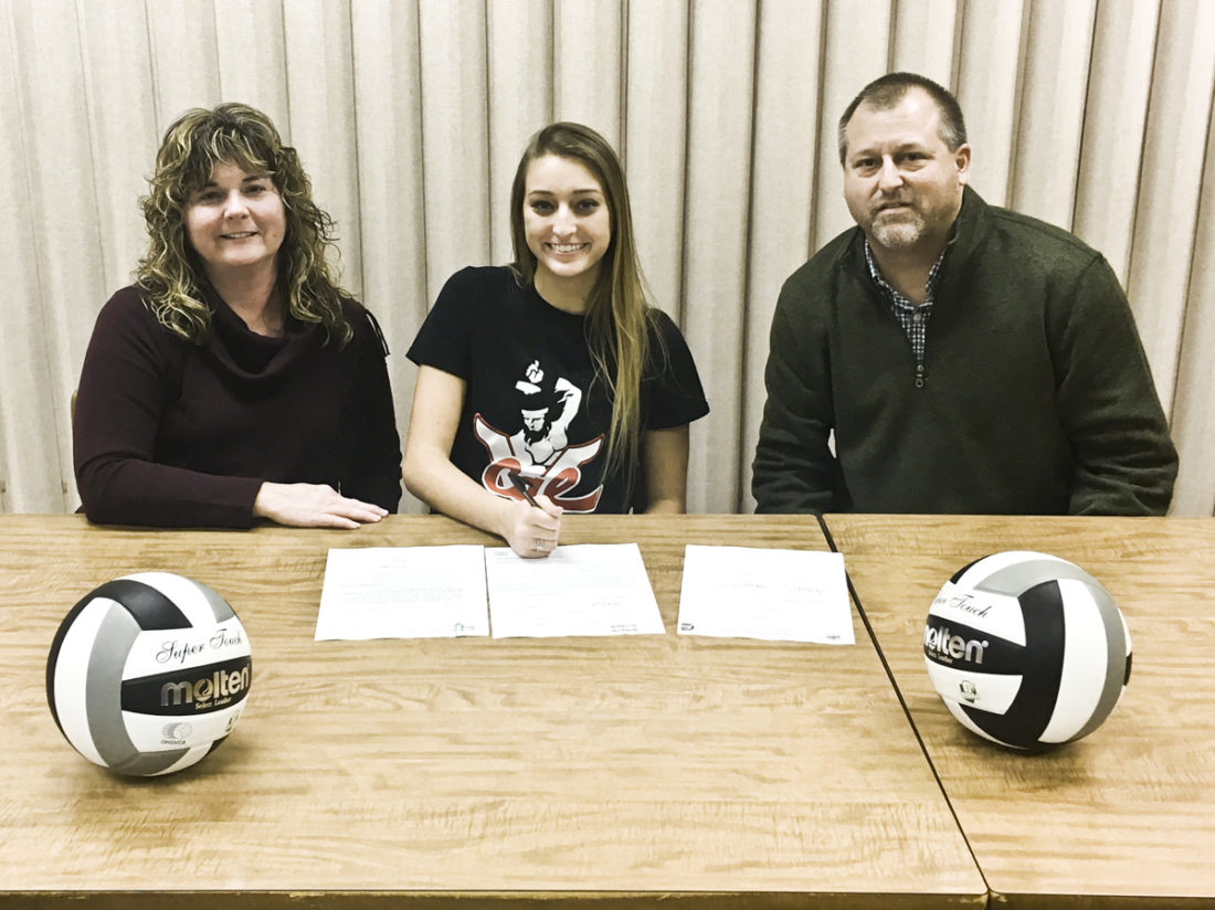 Special to Tribune Chronicle Jensen Silbaugh signs her letter of intent to play volleyball at California University of Pennsylvania.