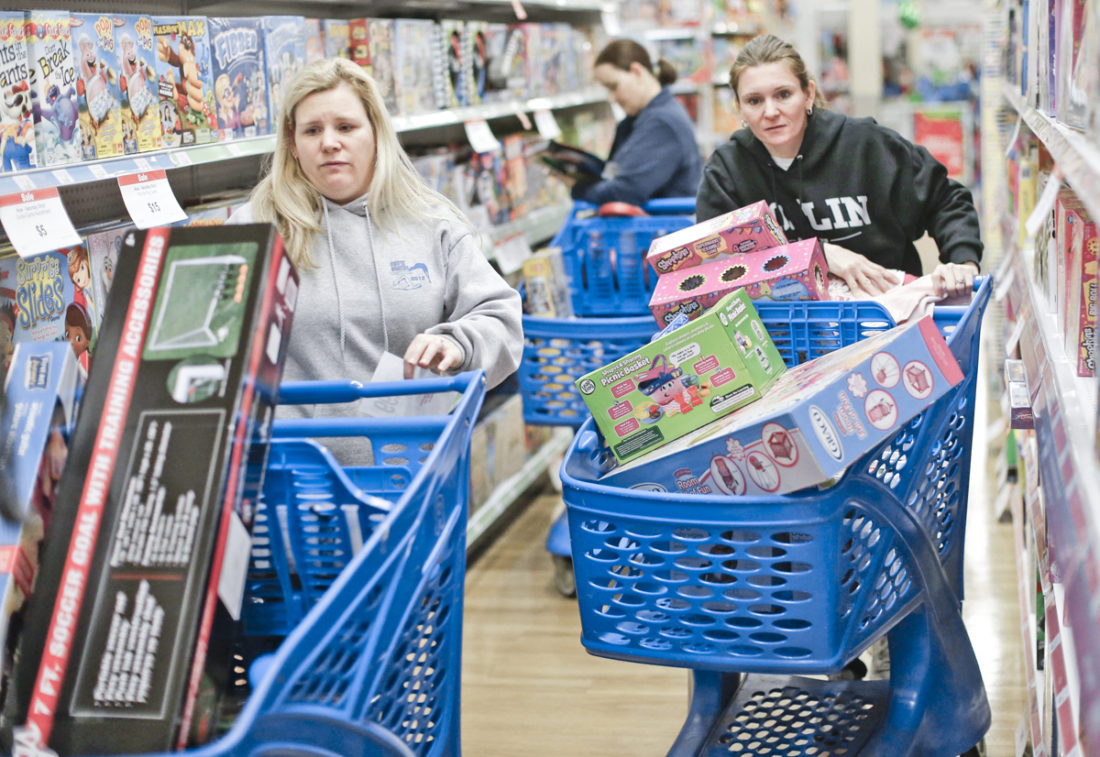 FILE - In this Friday, Nov. 27, 2015, file photo, cousins Stacy Levine, left, and Melissa Bragg shop at a Toys R Us store in Atlanta on Black Friday. Serious deal-seekers are already planning their Thanksgiving weekend shopping. Experts believe that once again Thanksgiving will offer better deals than on the day afterward, and there are signs that many of the offers will look similar to those in 2015. Amid the clutter of deals clamoring for attention, smart and careful shoppers can come out ahead. (Bob Andres/Atlanta Journal-Constitution via AP, File)