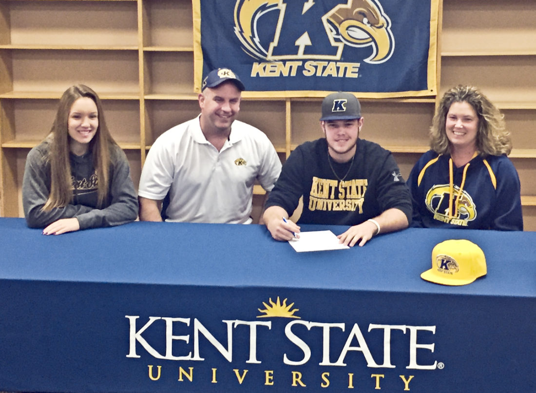 Special to Tribune Chronicle Champion's Michael Turner signs his letter of intent to play baseball at Kent State.