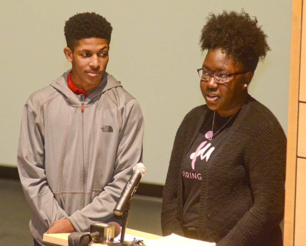 111416...R MENTORING 1...Champion...11-14-16... WGH student Willie Chatmon (correct), 16, left, listens to Jalaya Provitt of Warren, from Inspiring Minds, as she speaks during the kick-off for the My Brother's Keeper initiative , a mentoring program, helds at Kent State Trumbull Monday morning...by R. Michael Semple