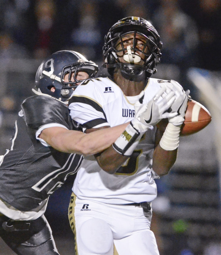 Tribune Chronicle / R. Michael Semple Warren G. Harding's Jalen Hooks makes a reception of a long Lynn Bowden pass over Hudson's Evan Westerbeck during Friday's Division II, Region 5 final. Hudson won, 24-21.