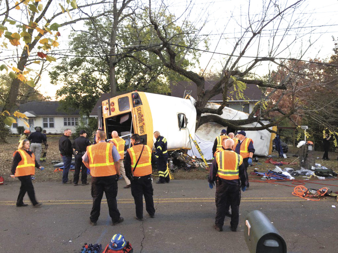 In this photo provided by the Chattanooga Fire Department via Chattanooga Times Free Press, Chattanooga Fire Department personnel work the scene of a fatal elementary school bus crash in Chattanooga, Tenn., Monday, Nov. 21, 2016. In a news conference Monday, Assistant Chief Tracy Arnold said there were multiple fatalities in the crash. (Bruce Garner/Chattanooga Fire Department via Chattanooga Times Free Press via AP)
