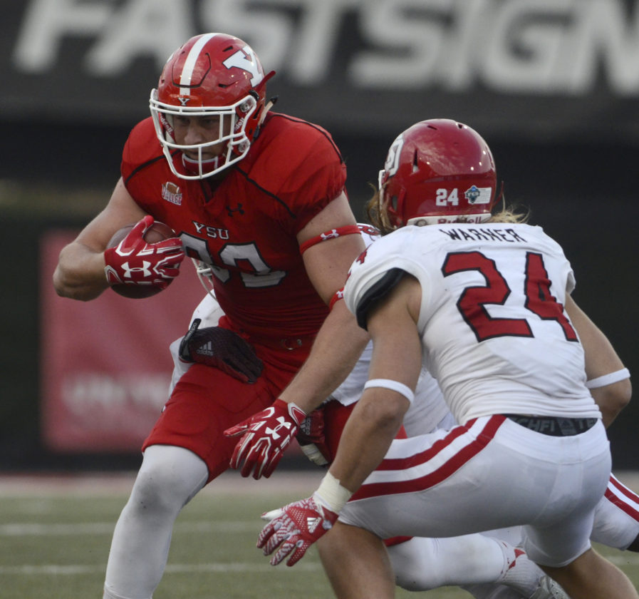 Tribune Chronicle file / R. Michael Semple YSU tight end Kevin Rader, shown here making a move on South Dakota's Jacob Warner, is part of a massive offensive line for the Penguins.