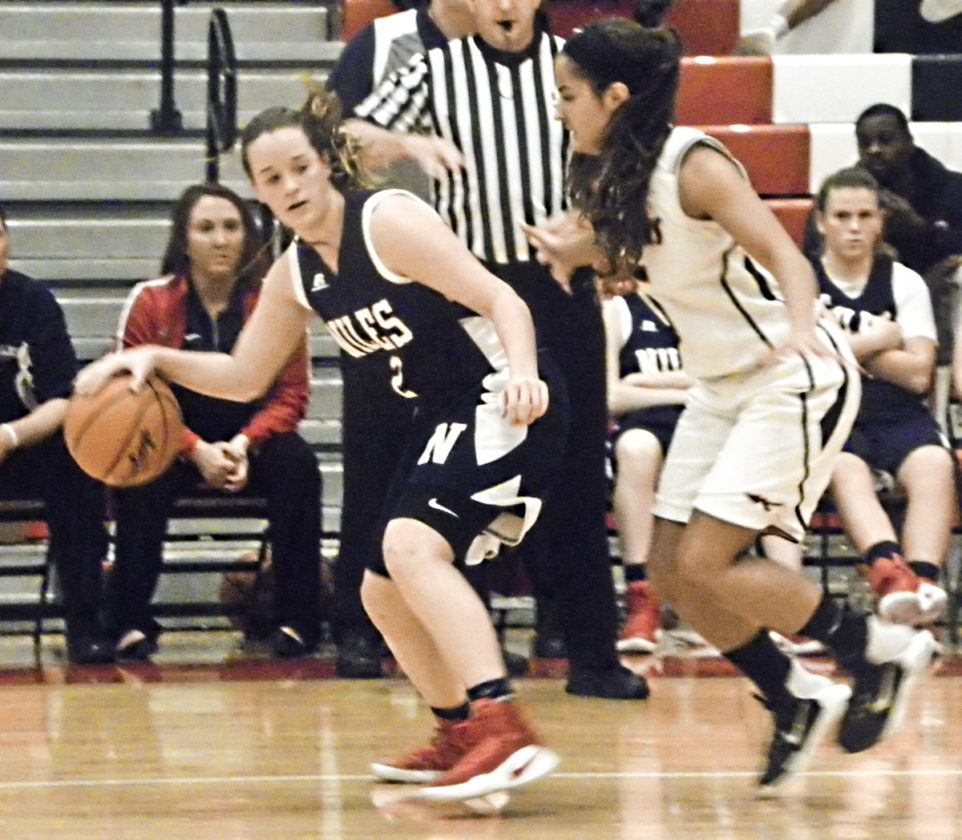 Tribune Chronicle / Eric Murray Niles' Amanda Blank, left, dribbles while being pressured by Girard's Makayla Trebella during their game Wednesday. Girard won, 50-39.