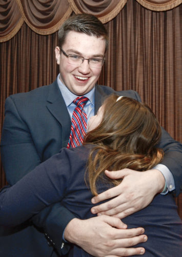 Tribune Chronicle / R. Michael Semple  Ryan Jones, 18, a senior at Howland High School, is all smiles Thursday as he gets a hug from his sister, Lauren, 12, after he was named the top recipient of the Twenty Under 20 award. Jones won the honor partly for founding a program inspired by Lauren, who has Down syndrome.
