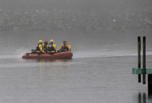 A boat carrying a recovery team rides on the shoreline of Lake Erie, Tuesday, Jan. 3, 2017, in Cleveland. Cleveland officials say the search for a plane carrying six people that disappeared last week over Lake Erie has resumed. Tuesday marks the third straight day that conditions have allowed recovery teams to search the lake for a Columbus-bound Cessna 525 Citation that vanished from radar shortly after takeoff Thursday night from Burke Lakefront Airport. (AP Photo/Tony Dejak)