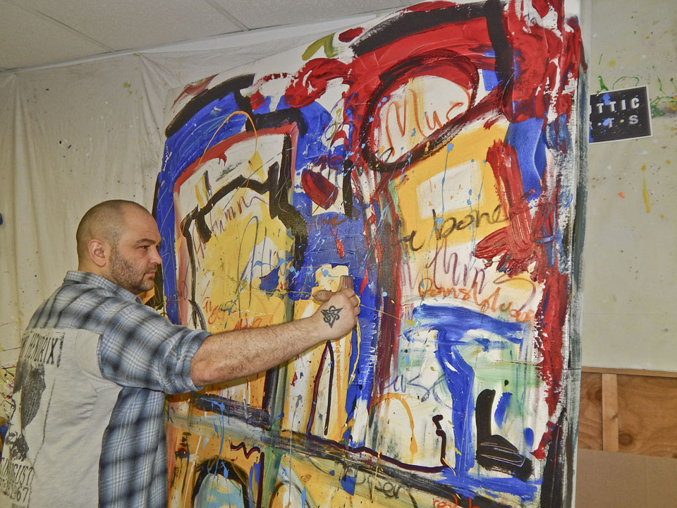 James Shuttic of Art on the Park in Warren works on one of his art pieces.