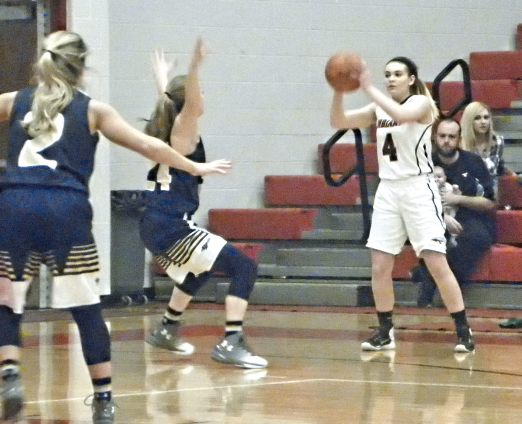 Tribune Chronicle / Eric Murray Girard's Megan Payich (4) looks for a teammate against the Brookfield defense.