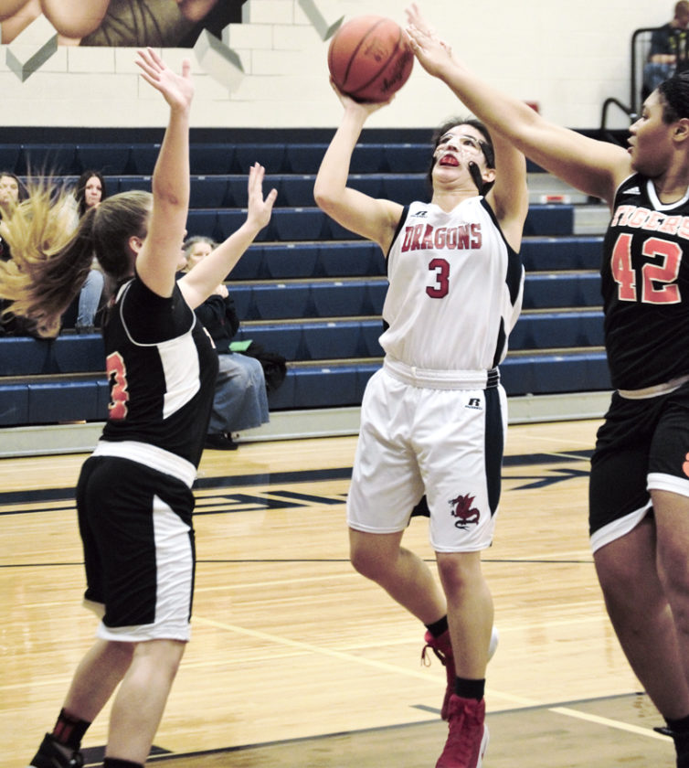 Tribune Chronicle / Bob Ettinger Niles senior Dakota Naples (3) recently reached the 1,000-point mark for her career.