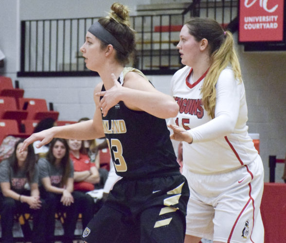 Tribune Chronicle / John Vargo YSU's Mary Dunn, right, posts up inside as Oakland's Leah Somerfield, left, fronts her defensively during Thursday's game.
