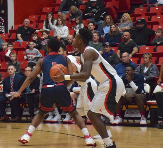 Tribune Chronicle / John Vargo Youngstown State's Braun Hartfield shoots a 3 against Detroit on Feb. 4. YSU plays Cleveland State in Detroit during a first-round game in Detroit.