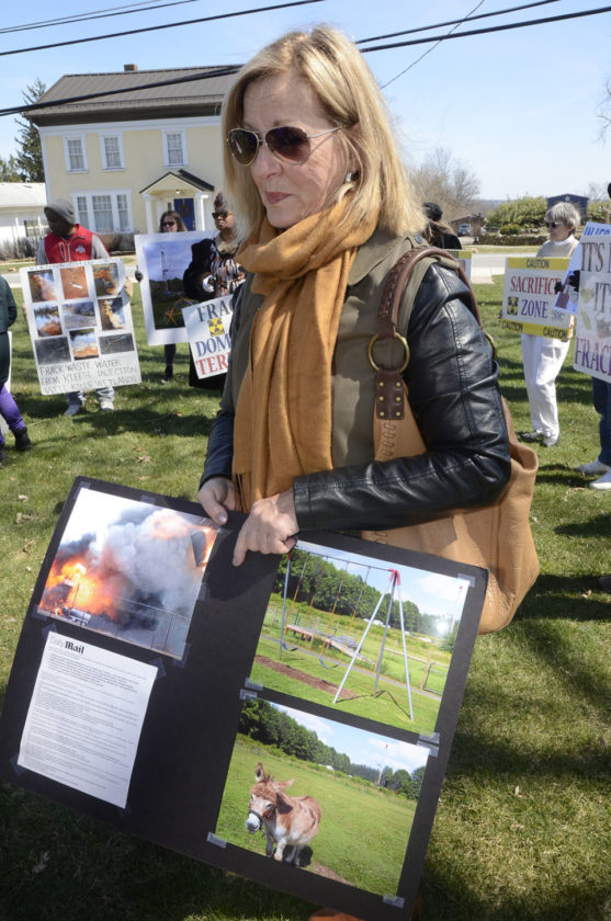 032317...R PROTEST WELLS 2...Brookfiled...03-23-17...Brookfield resident and retired Brookfield school teacher Judith Puskar attends the rally Thursday afternoon and gives her reasons for opposing the wells...by R. Michael Semple