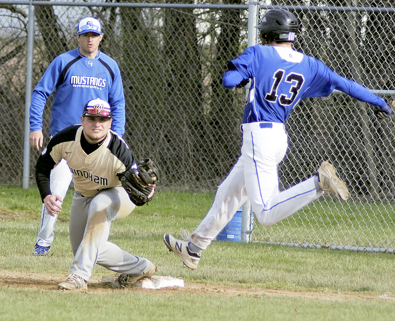 Tribune Chronicle / Bob Ettinger Windham first baseman Erik Roche secures the ball for the out as Josh Cunningham of Grand Valley hustles down the line Thursday at Grand Valley.