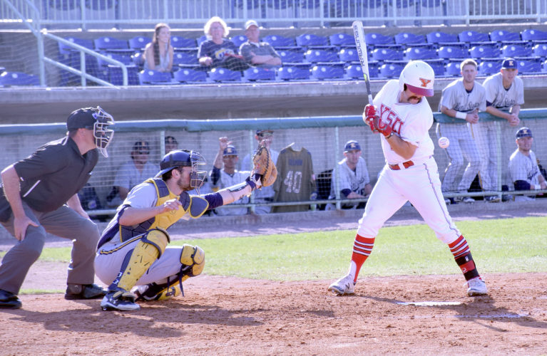 Tribune Chronicle / Joe Simon Youngstown State's Shane Willoughby is hit by a pitch from Kent State's Joe Vranesic as catcher Pete Schuler looks on during the Golden Flashes' 6-3 victory Tuesday at Eastwood Field.