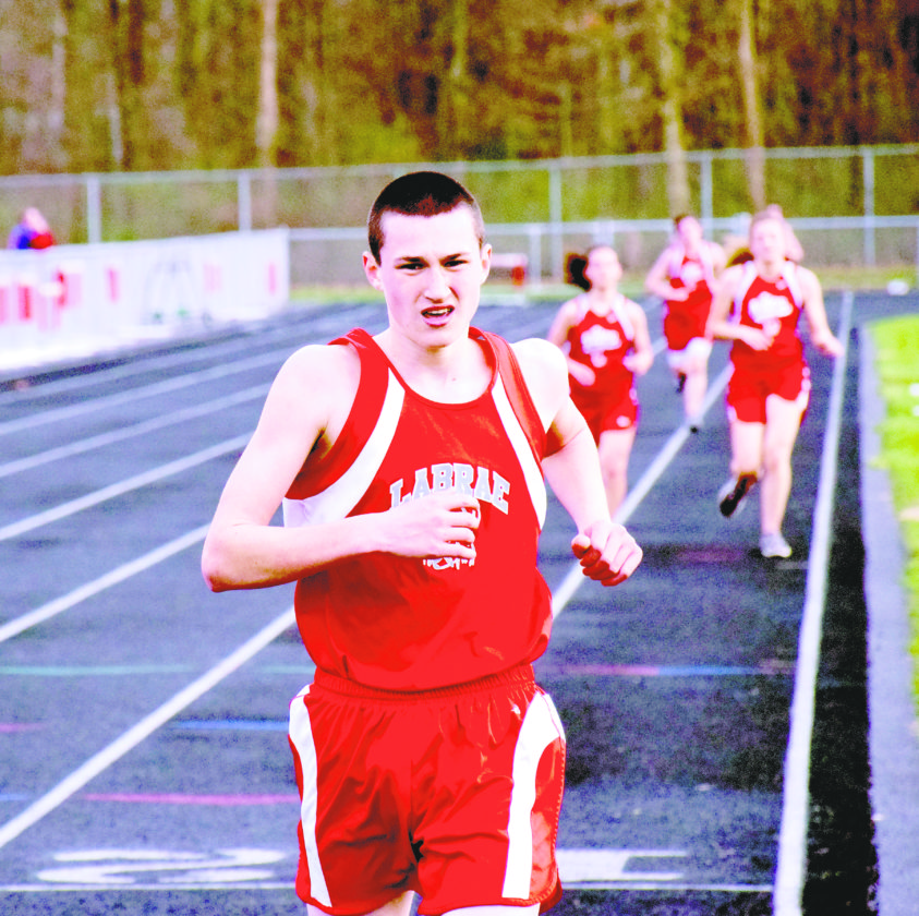 Tribune Chronicle / John Vargo LaBrae's Jakob Rose finishes running the 3,200, an event he won during the April 11 meet with Liberty, Girard and Niles. Rose, who played football his first two years of high school, shifted his focus to track.