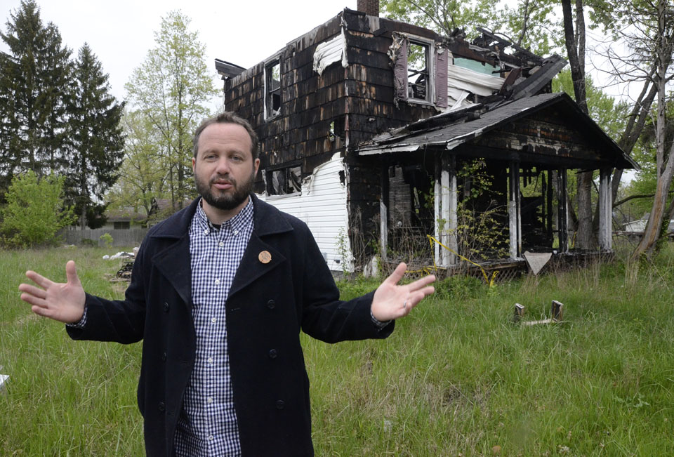 Trumbull Neighborhood Partnership director Matt Martin stands next to a house that is being demolished on Hamilton Street SW, the 300th being razed in Warren. Martin said this house was put on the fast track for being taken down.  Tribune Chronicle / R. Michael Semple