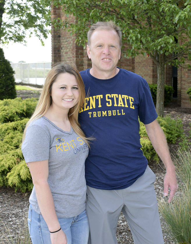 Tribune Chronicle / John Vargo Niles graduate Briana Ellwood (left), a soon-to-be Kent State Trumbull sophomore, is the first committed runner to the Golden Flashes cross country program. With her is coach Bill Hess.