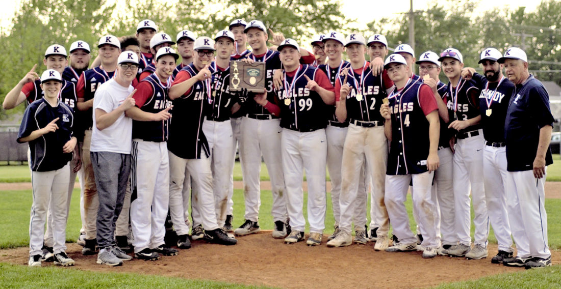 Tribune Chronicle / Bob Ettinger The John F. Kennedy baseball team poses after claiming the Division IV district championship at Urbansky Field in Fairport Harbor on Thursday evening. The Eagles defeated Mathews, 5-4, in eight innings.