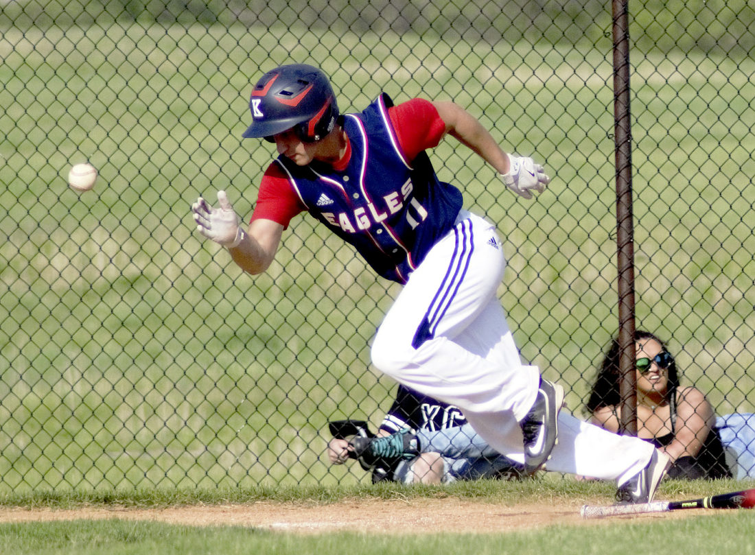 Tribune Chronicle / Bob Ettinger John F. Kennedy's Alec Burzynski successfully drops down a bunt in a Division IV district championship victory over Mathews at Fairport Harbor on Thursday.