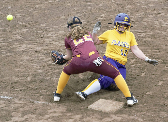 Tribune Chronicle / Bob Ettinger Gabby Hollenbaugh of Champion slides safely into third as Cardinal Mooney third baseman C.J. Sapp awaits the ball in a Division III regional semifinal at Massillon on Wednesday. The Golden Flashes blitzed the Cardinals, 11-0, to advance to Saturday's regional final.