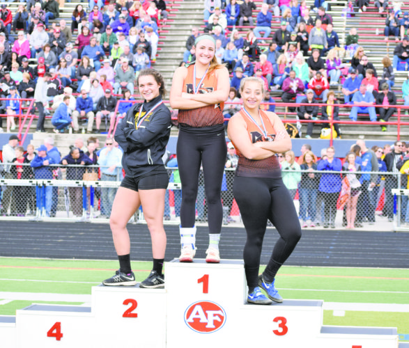 John Vargo / Tribune Chronicle Garfield's Lauren Jones, left, Newton Falls' Isabelle Kline, middle, and Kayla Barreca pose on the podium at the Division II Austintown regional final after finishing first, second and third in the shot put event Thursday.