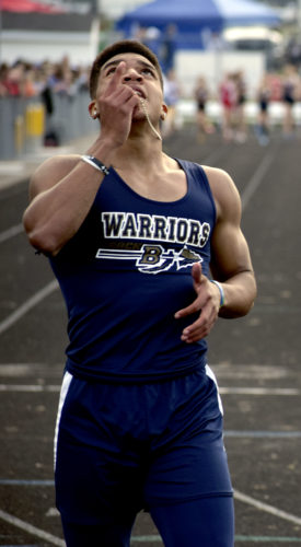 Tribune Chronicle / John Vargo Brookfield's Xavier Bailey celebrates after winning the 200-meter dash Friday in the Division IIIregional meet at Massillon Perry.