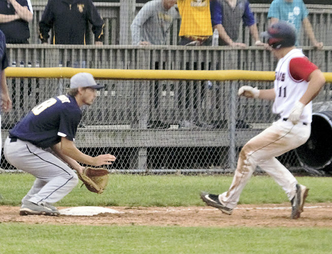 Tribune Chronicle / Bob Ettinger John F. Kennedy's Alec Burzynski coasts into the bag as New Riegel third baseman Brandon Arbogast waits for the ball Friday in the Eagles' 2-0 loss in a Division IVregional semifinal at Lorain.