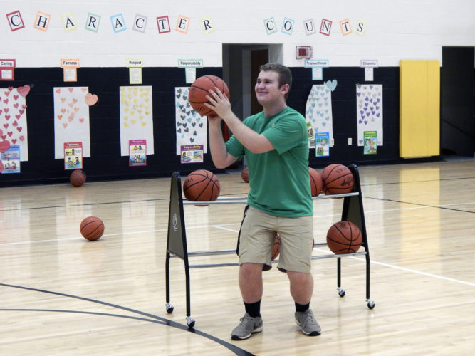 Tribune Chronicle / Bob Coupland Devon Johnson of Bristol, a junior at Trumbull Career and Technical Center, shoots basketballs at the Dribble for a Cause fundraiser at Bristol High School to benefit the Kayla Irene Daniels Cure for Cancer Foundation. Participants had to dribble basketballs for a period of time.