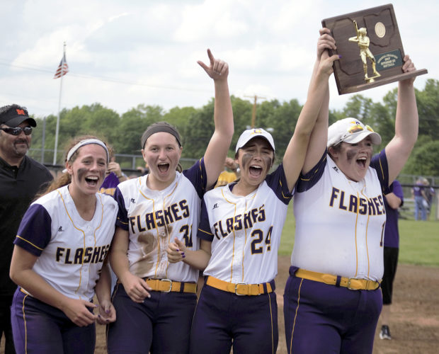 Tribune Chronicle / Bob Ettinger McKenzie Zigmont, Molly Williams, Alex Steigerwald and Jackie Mulvain hold the trophy high as they celebrate the Champion softball team's regional championship Saturday at Massillon.