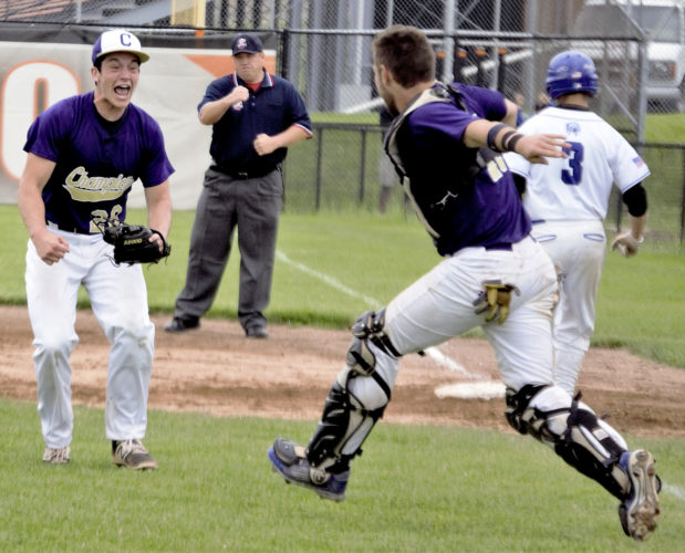 Tribune Chronicle / Bob Ettinger Champion pitcher Andrew Russell, left, runs toward catcher Michael Turner in the moments following a Division III regional championship victory over Chippewa at Massillon Washington on Saturday afternoon.