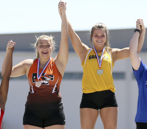 MICHAEL G. TAYLOR- 06-02-17 OHSAA State Track & Field Championships. D2 Girls Discuss,, Newton Falls' Kayla Barreca and Garfield's Lauren Jones celebrate their 1st (Lauren Jones) and second place finishes.