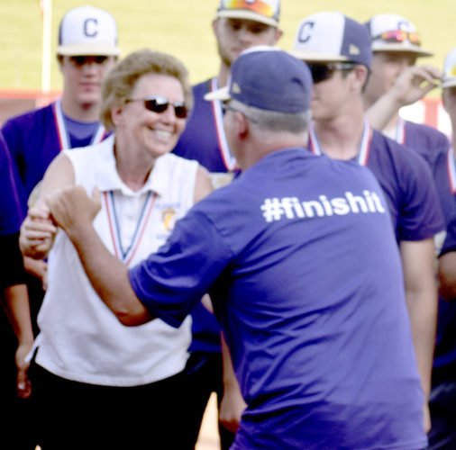 Tribune Chronicle / Eric Murray Champion softball coach Cheryl Weaver and baseball coach Rick Yauger embrace Saturday at Akron after their teams both won Division IIIstate titles.