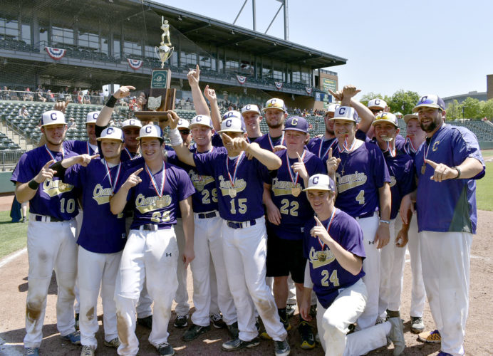 Tribune Chronicle / Joe Simon Members of the Champion High School baseball team show off the state championship trophy they won Saturday with a 1-0 victory over Berlin Hiland at Columbus.