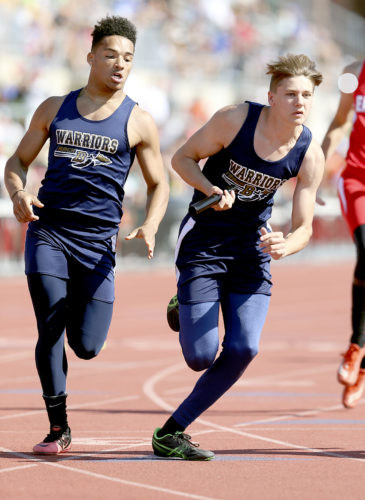MICHAEL G. TAYLOR- 06-03-17 OHSAA State Track & Field Championships. D3 Boys 4x200m, Brookfield's Dione Colwell hands the batton to his teammate Alex Bell