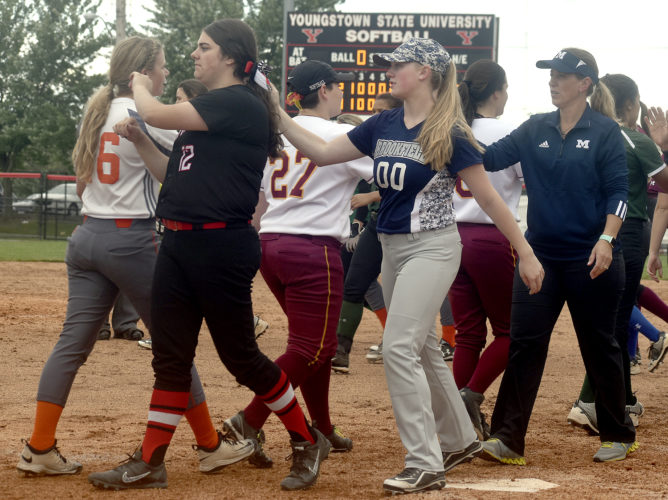 Tribune Chronicle / Eric Murray Members of the Trumbull County all-star team, from left, Girard's Emily Scarnecchia, Brookfield's Ella Simcox and coach Michelle Titus congratulate members of the Mahoning County team after the first game of the 14th annual Bill Sferra Fastpitch Classic held Tuesday at Youngstown State.