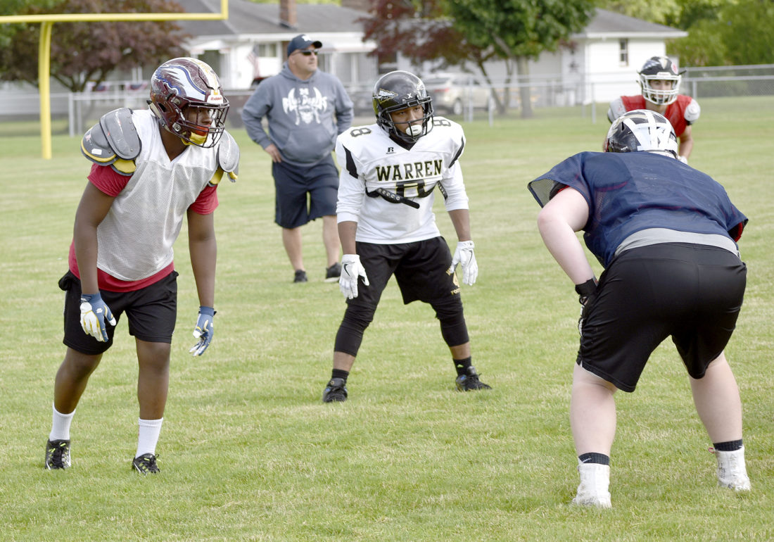 Tribune Chronicle / Joe Simon Liberty graduate John Spivey, left, practices with the Trumbull County team this week in preparation for the Jack Arvin All-Star Classic football game scheduled Thursday at Hubbard.