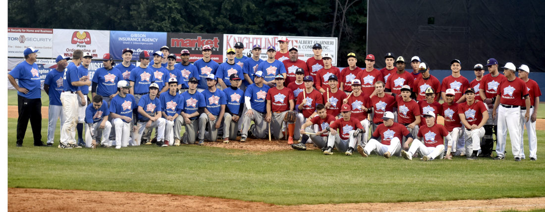 Tribune Chronicle / Eric Murray Teams from Trumbull and Mahoning Counties take a picture following Friday's All-Star Game in Niles.