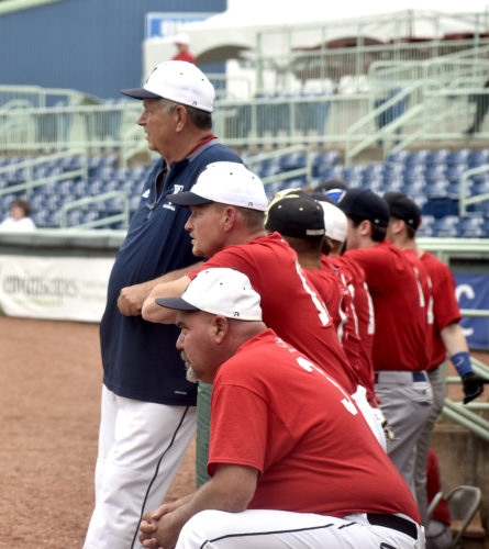 Tribune Chronicle / Eric Murray John F. Kennedy coach Don Lee, standing, and other coaches look on during Friday's Mahoning Valley Scrappers High School Valley All-Star Classic.