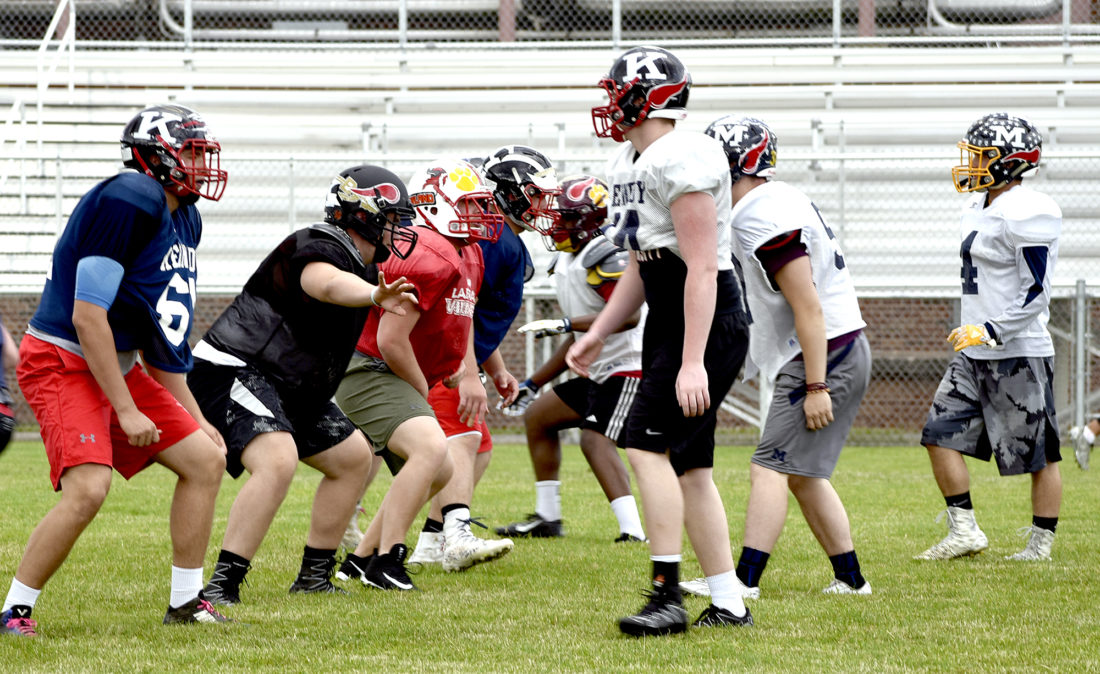 Tribune Chronicle / Joe Simon Linemen from the Trumbull County team run through a drill during a recent practice for tonight's Jack Arvin Classic in Hubbard as they face the Mahoning County team.