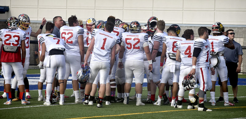Tribune Chronicle / Eric Murray The Trumbull County team huddles up prior to Thursday's Jack Arvin Classic in Hubbard. Trumbull defeated the Mahoning County team, 20-7.
