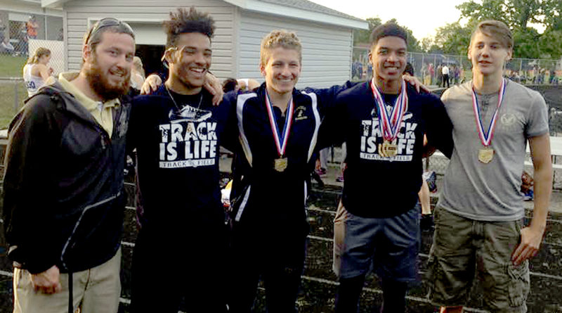 Special to Tribune Chronicle Brookfield track and field coach Adam Hughes, left, with the Warriors' 4x200 relay team, from left, Dionte Colwell, Nicholas Varga, Xavier Bailey and Alexander Bell.