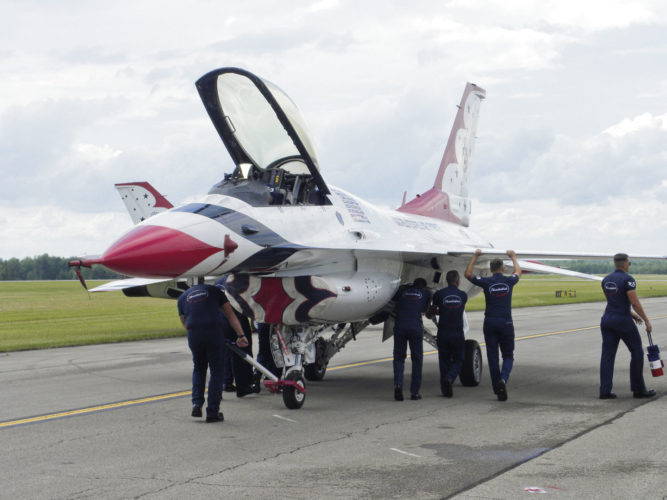 Ground crews move one of the Thunderbirds' F-16s into position after their three-hour flight from Nellis Air Base in Nevada to the Youngstown Air Reserve Base in Vienna on Thursday for the Thunder Over the Valley show on Saturday. The show will include six F-16s performing aerial stunts and maneuvers Saturday at the Youngstown Air Reserve Base in Vienna.